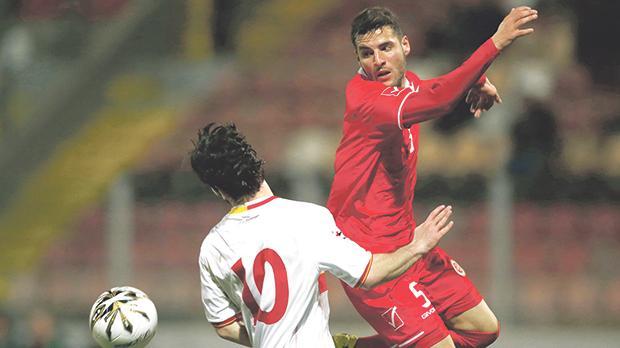 Samir Arab (left) in action during MaltaU-21's qualifier against Montenegro in March 2016.