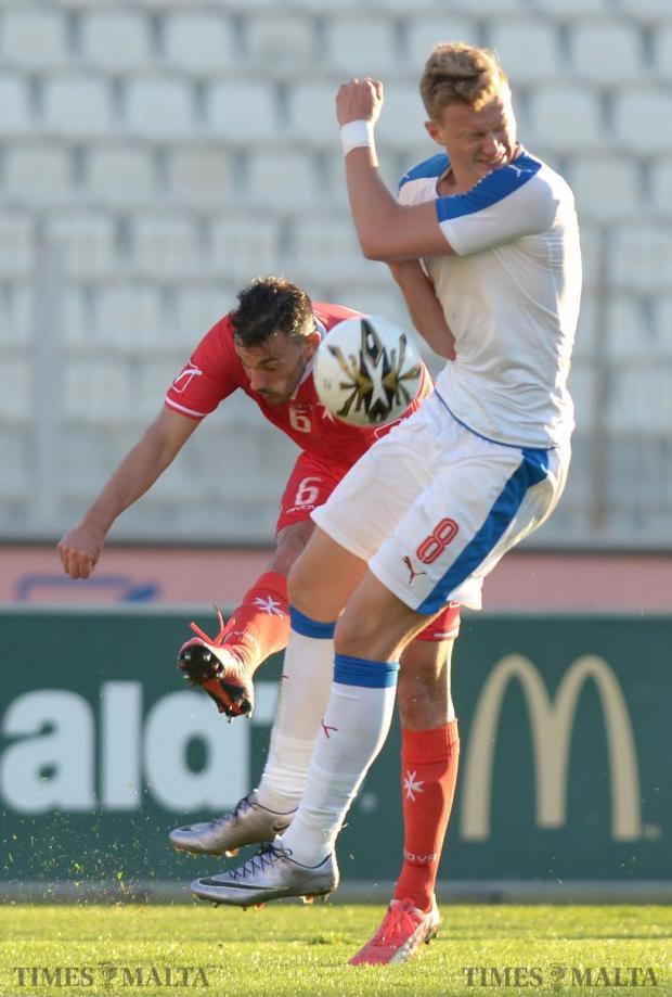 Malta's Daniel Zerafa (left) and Czech Republic's Antonin Barak clash during their UEFA U21 Championship qualifying match at the National Stadium in Ta'Qali on March 29. Photo: Matthew Mirabelli