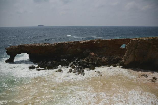 Murky brown seas wash what was once Għar Ħanex away. Photo: Jonathan Borg