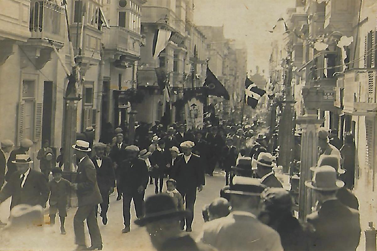 Gunlayer Street (Strada Miratore), Floriana, during the feast of St Publius in the 1930s. At the end of the street one can see the silhouette of the triumphal arch.