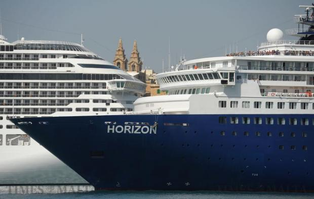 Two cruise liners cross paths in the Grand Harbour on October 4. Photo: Matthew Mirabelli
