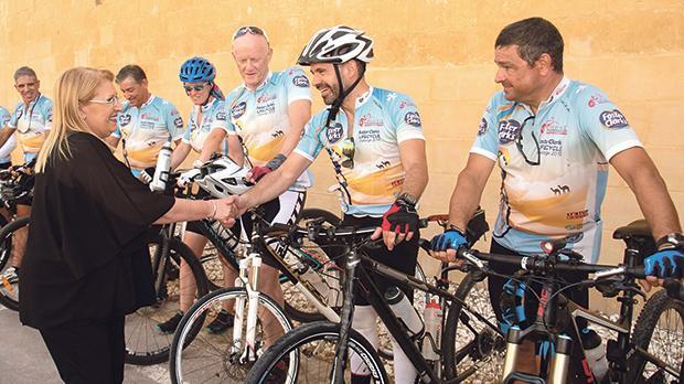 President Marie-Louise Coleiro Preca congratulating the cyclists.