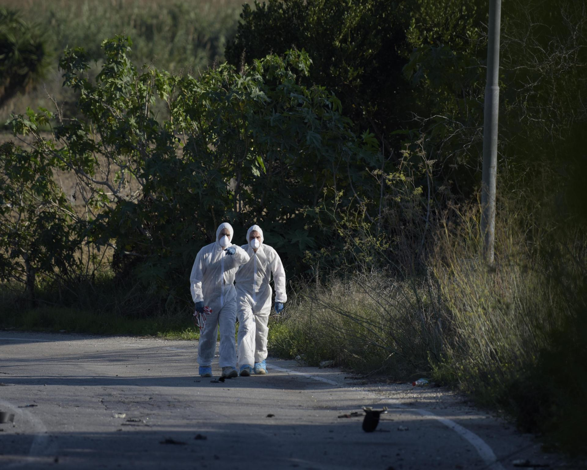 Forensic investigators at the scene where journalist Daphne Caruana Galizia was murdered in October 2017. Photo: Mark Zammit Cordina