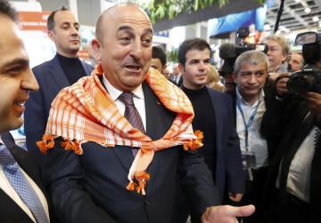 Turkish foreign minister says going to Rotterdam despite public rally ban