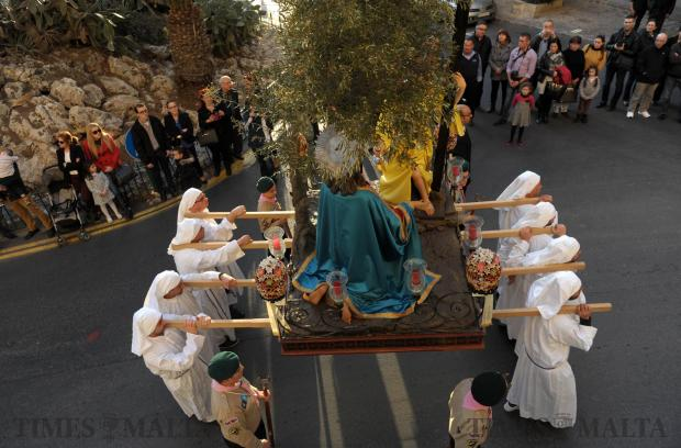 Participants carry a statue during a Good Friday procession in Birgu on March 25. Photo: Matthew Mirabelli