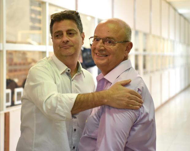 PN Leader Contestant Adrian Delia hugs newly elected European Parliament member Francis Zammit Dimech at the Naxxar Counting hall on July 18. Photo: Mark Zammit Cordina