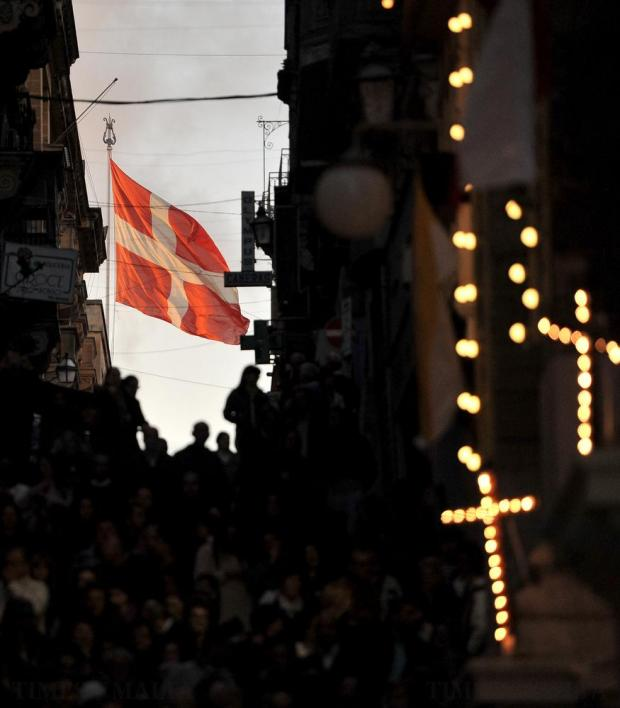 Illuminated crosses and flags on display at the Our Lady of Sorrows procession at the Ta' Giezu church in Valletta on March 18. Photo: Chris Sant Fournier