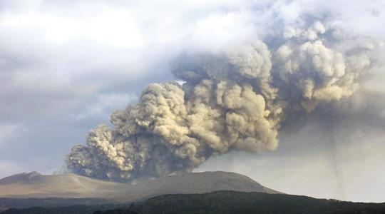 A plume of smoke rises from the crater of Mount Shinmoedake in the Kirishima mountain range of Kagoshima prefecture on Japan's southern island of Kyushu yesterday.A series of spectacular eruptions from a volcano in southern Japan fired columns of ash and smoke thousands of metres in the air, with the cloud delaying some international flights to Tokyo.
