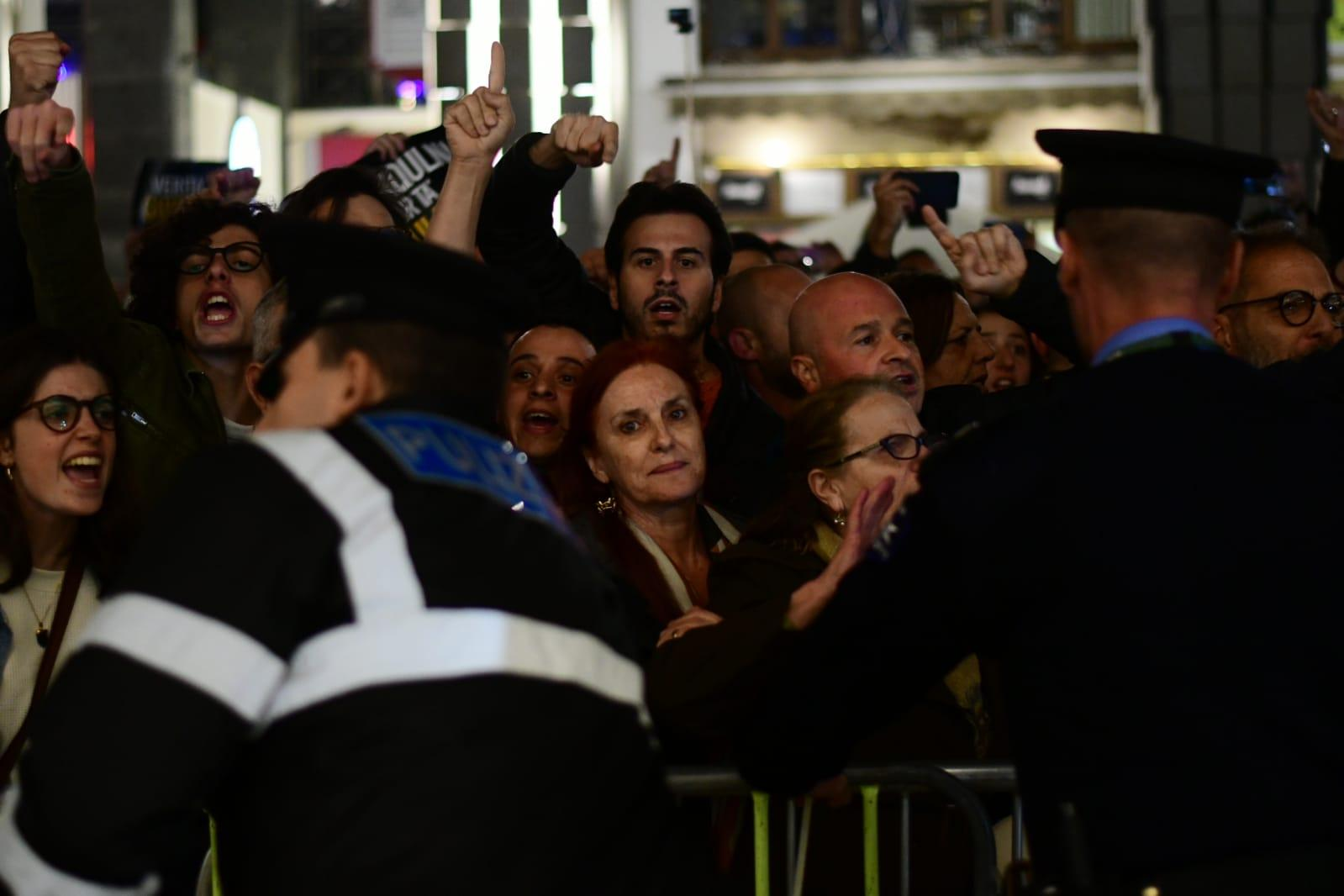 Police keep an eye on protesters in Valletta on Tuesday evening. Photo: Jonathan Borg