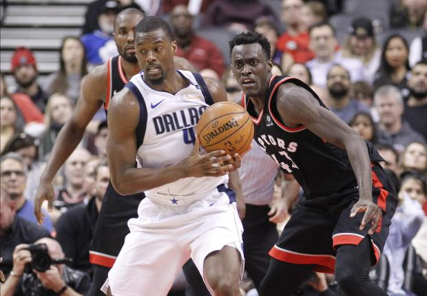Toronto Raptors forward Serge Ibaka (9) and forward Pascal Siakam (43) defend against Dallas Mavericks forward Harrison Barnes (40) at the Air Canada Centre. Toronto defeated Dallas in overtime. Photo Credit: John E. Sokolowski-USA TODAY Sports