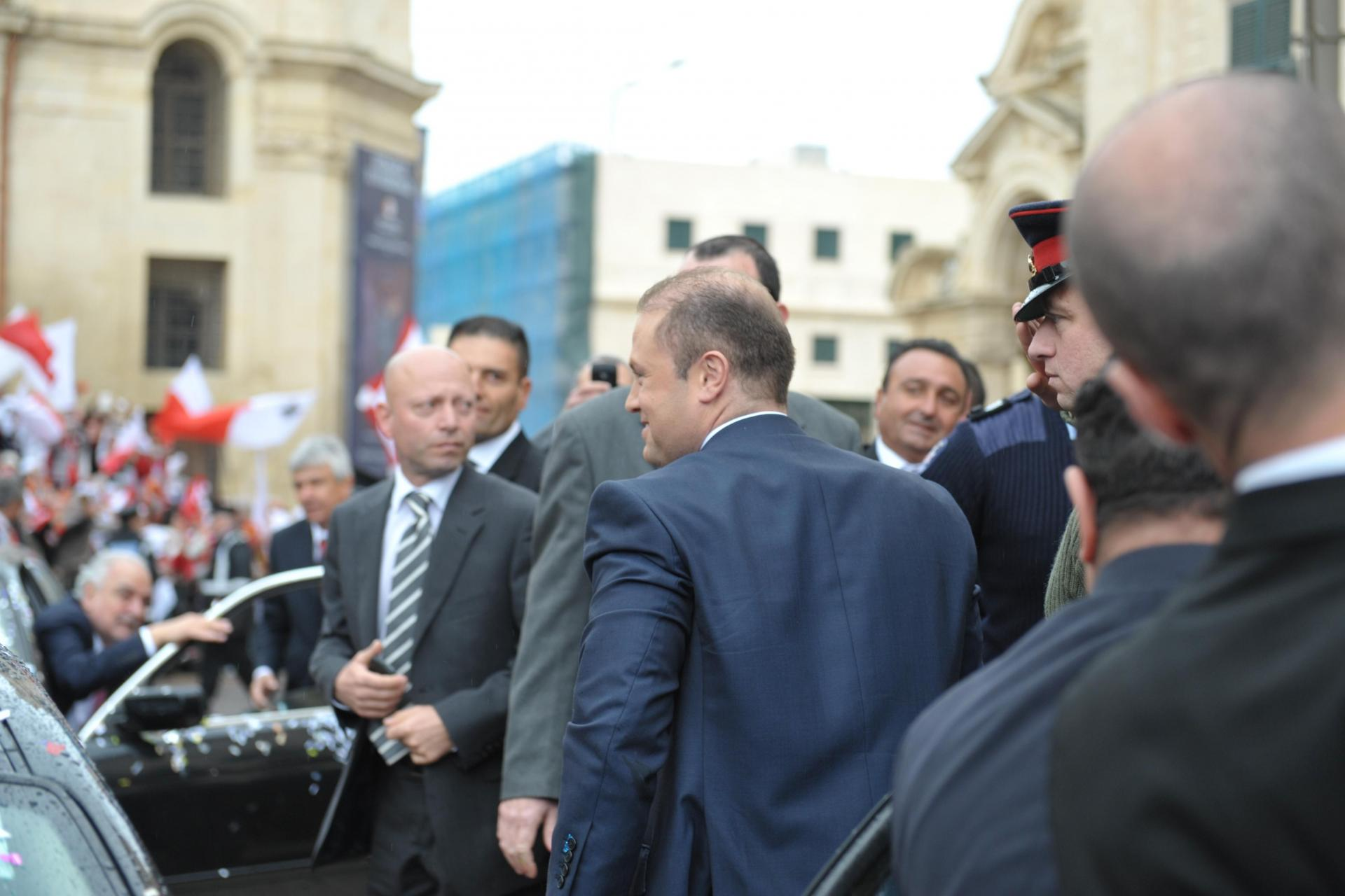 Mr Barbara (first left) outside Castille with Joseph Muscat in March 2013, when the Labour Party won the general election. Photo: Matthew Mirabelli