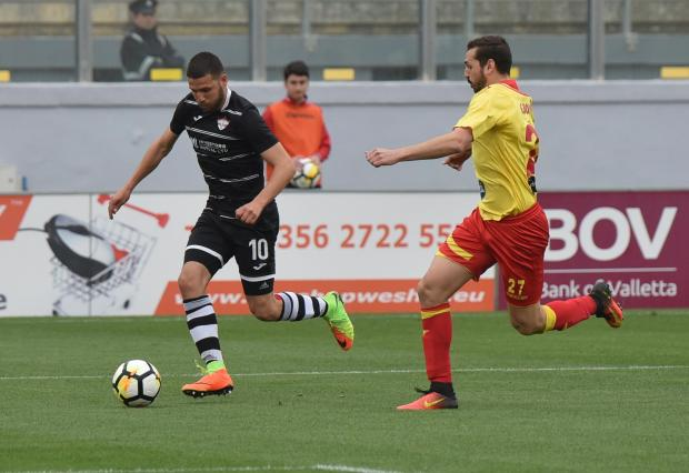 Siraj Arab (left) of Balzan advances towards goal against Senglea Athletic. Photo: Mark Zammit Cordina