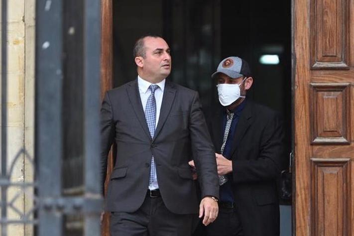 Construction worker Nicholas Spiteri leaves court on Wednesday with lawyer Franco Debono. Photo: Mark Zammit Cordina