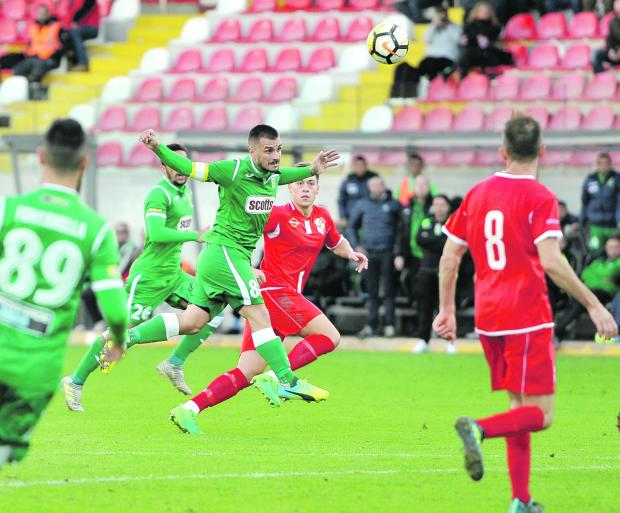 Nicolas Chiesa (centre) in action for Floriana against Naxxar Lions.