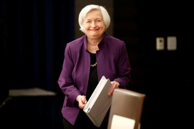 Dollar slides after Fed's Yellen makes no monetary policy comment