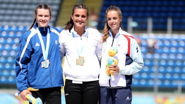 Charlotte Wingfield (centre) poses with the gold medal.
