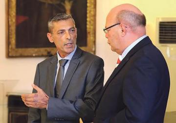 Simon Schembri (left) with the police commissioner