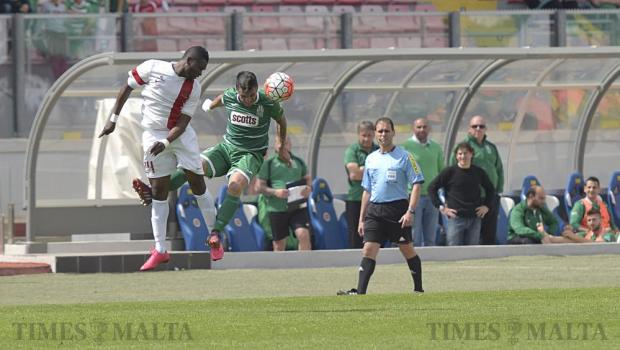 Valletta's Umeh Calistus and Floriana's Nicolas Chiesa jump for a high ball during their Premier League derby match at the National Stadium in Ta' Qali on April 9. Photo: Mark Zammit Cordina
