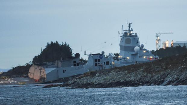 """Norwegian frigate KNM Helge Ingstad takes on water after a collision with the tanker """"Sola TS"""" in Oygarden."""
