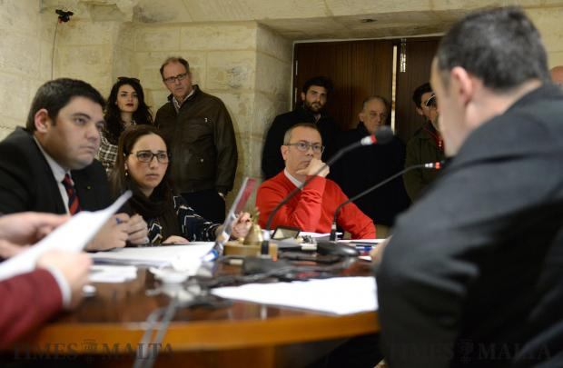 Members of the Valletta Local Council discuss the motion to remove the makeshift memorial for Daphne Caruana Galizia from the Great Siege Monument as her widower Peter Caruana Galizia looks on at the Local Council Office in Valletta on February 13. Photo: Matthew Mirabelli