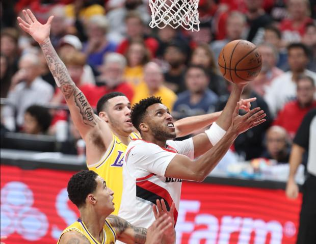65643f9ffe95 Watch  LeBron loses Lakers debut at Portland. Portland Trail Blazers s Evan  Turner shoots over Lonzo Ball