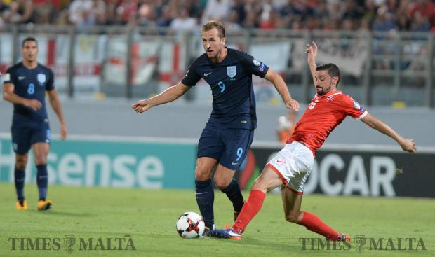 England' Harry Kane (left) tries to make his way past Malta's Ryan Fenech during their FIFA 2018 World cup Qualifying Group F Match against Malta at the National Stadium in Ta'Qali on September 1. Photo: Matthew Mirabelli