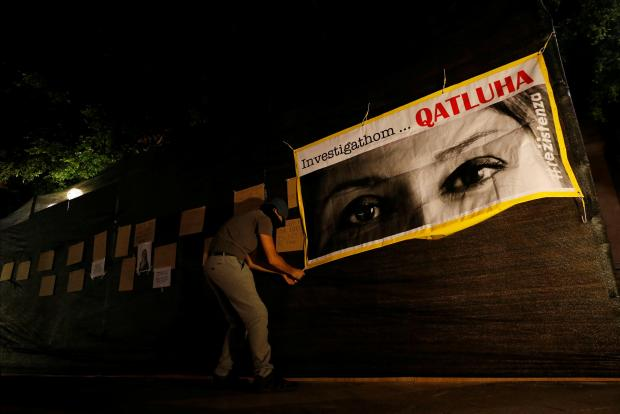 A Reżistenza activist puts up the banner overnight. Photo: Darrin Zammit Lupi/Reuters