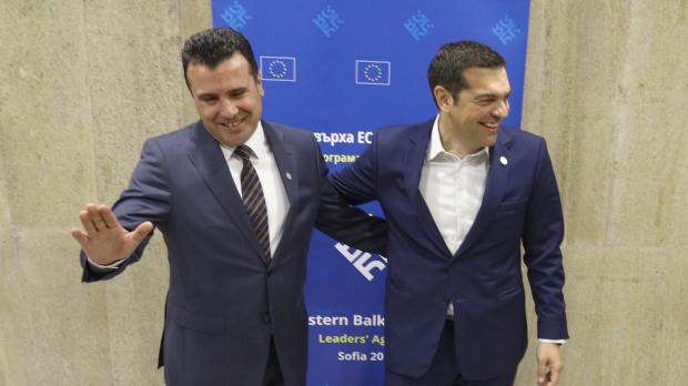 Macedonian Prime Minister Zaev and Greek Prime Minister Tsipras joke at a summit in Sofia last month. Photo: Reuters.