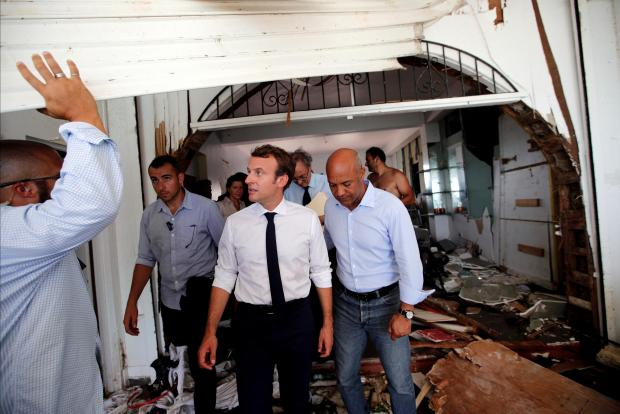 France's President Emmanuel Macron looks on in destroyed building during his visit to St Martin. Photo: Reuters