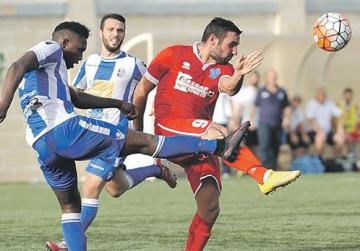 No risks... Mosta's Kevaun Atkinson clears the ball away from Tarxien striker Alex Nilsson. Photo: Chris Sant Fournier