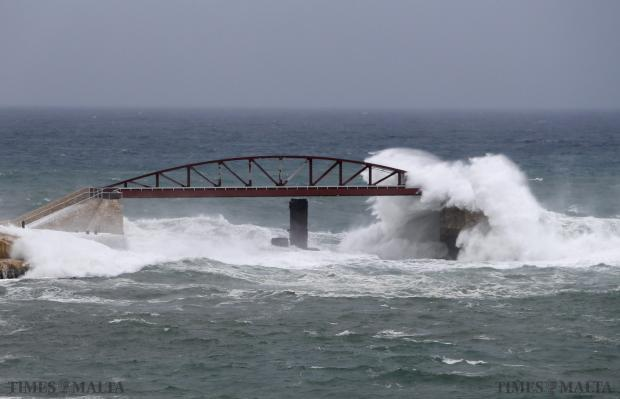 Waves crash against the breakwater bridge at the mouth of Valletta's Grand Harbour on January 1. Photo: Darrin Zammit Lupi