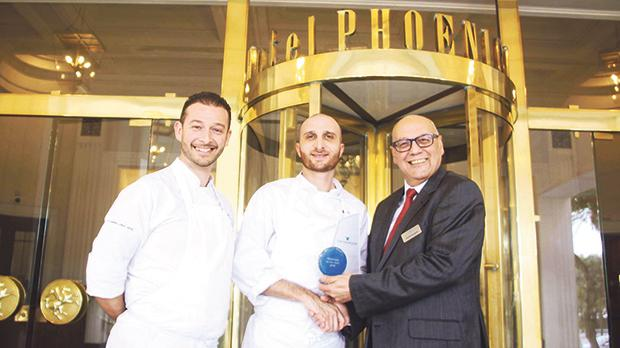 Chef Gary Grima holding his trophy, flanked by Charles Azzopardi and Daniel Debattista (left).