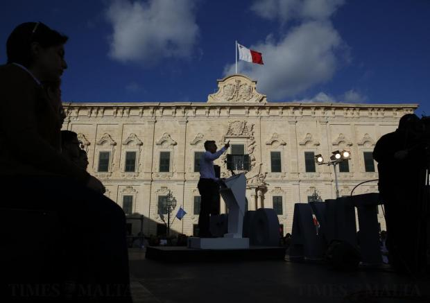 Opposition and Nationalist Party leader Simon Busuttil addresses protestors during a demonstration calling on Prime Minister Joseph Muscat to resign after two members of his government were named in the Panama Papers leak scandal, outside the office of the Prime Minister at Castille Place in Valletta on April 10. Photo: Darrin Zammit Lupi