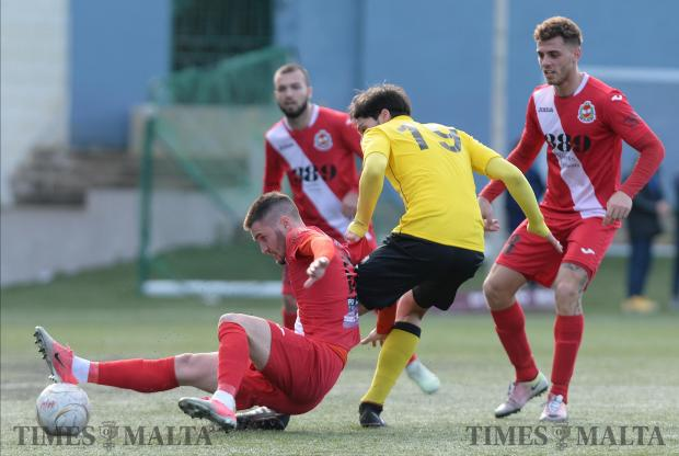 Mqabba's Tomilsav Trebovac (left), tries to keep Qormi's Chris Vella away from the ball during their BOV First Division match at the Victor Tedesco Stadium in Hamrun on February 11. Photo: Matthew Mirabelli