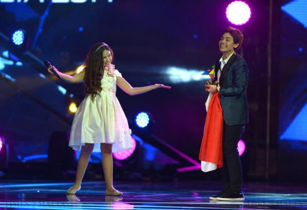 Italy's Vincenzo Cantiello is presented the Junior Eurovision Song contest trophy by last year's winner Gaia Cauchi at Marsa on November 15. Photo: Matthew Mirabelli