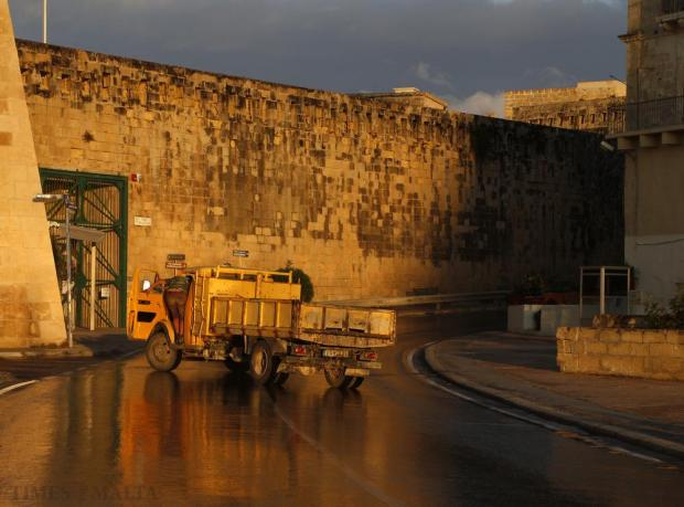 A man climbs into a yellow truck outside Fort St Elmo just before sunset on October 27. Photo: Darrin Zammit Lupi