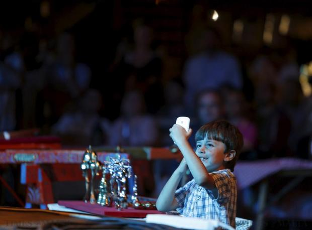 A boy shoots a video on his smartphone as Indian sitar player Ashwin Batish (not pictured) performs with his Sitar Power band at the Ghanafest folk music festival at Argotti Gardens in Floriana on June 13. The three-day festival is a showcase of Maltese folksong as well as international music folk fusion music. Photo: Darrin Zammit Lupi