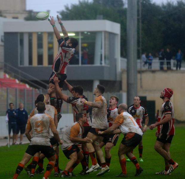 Team Malta and Cyprus share some mud during a messy and wet rugby encounter at Hibernians Stadium, with the Maltese coming out winners 31-3, in Corradino on October 29. Photo: Steve Zammit Lupi