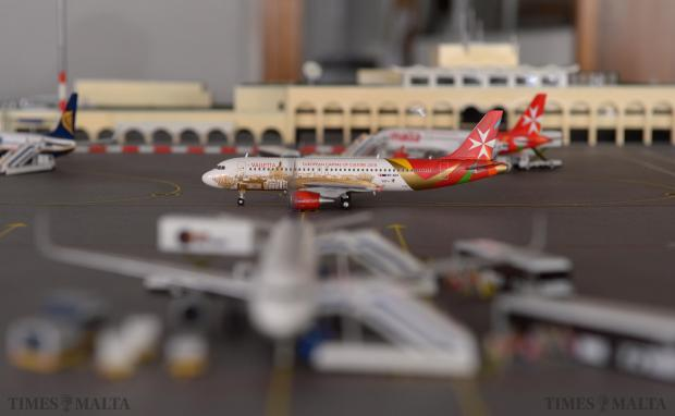 An Air Malta plane on the apron of Malta International Airport forms part of a thematic exhibit on display at the annual show of the Die Cast and Scale Model Society at the Easysell showroom in Qormi on December 7 Photo: Matthew Mirabelli