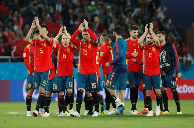 Spain players applaud fans after the match.