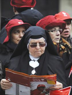 "This file photo shows a nun reading an anti-abortion brochure reading ""The right to live"" while attending a demonstration to protest against the government's plans to liberalise the abortion law in Madrid. Photo: Pierre-Philippe Marcou/AFP"