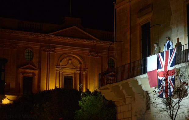 A British and Maltese flag are held from the balcony of Casino Maltese in Republic Street, Valletta during a commemorative ceremony held at St George's Square, Valletta on April 14, celebrating the 73rd anniversary of King George VI's proclamation on April 15, 1942, awarding Malta the George Cross. Photo: Matthew Mirabelli