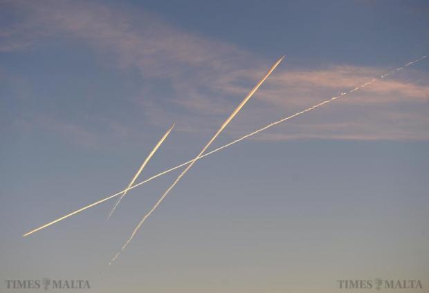 Three planes cross paths whilst flying over Malta on December 16. Photo: Matthew Mirabelli