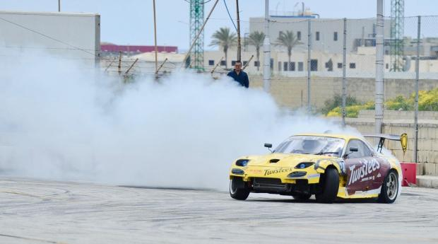 A cloud of smoke rises as a car drifts during the Malta Drifting Championships at Hal-Far on April 2. Photo: Steve Zammit Lupi