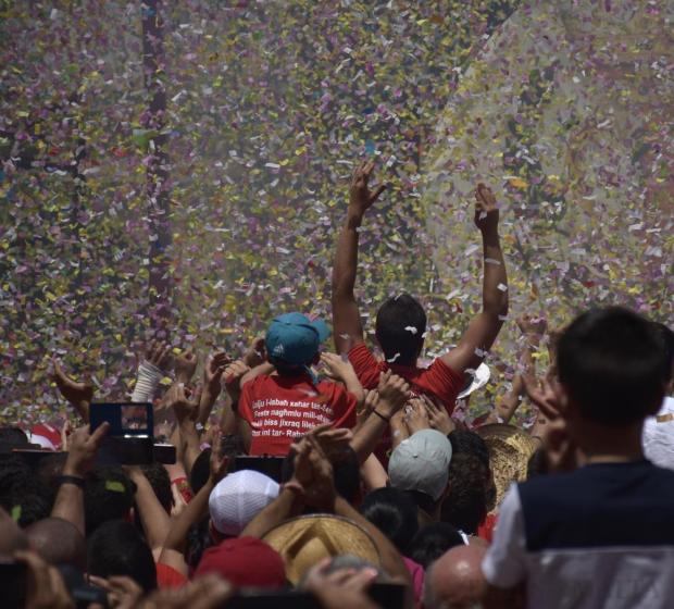 Feast goers celebrate at the end of a confetti display synchronised with music during the feast of St Paul in Rabat on July 3. Photo: Mark Zammit Cordina