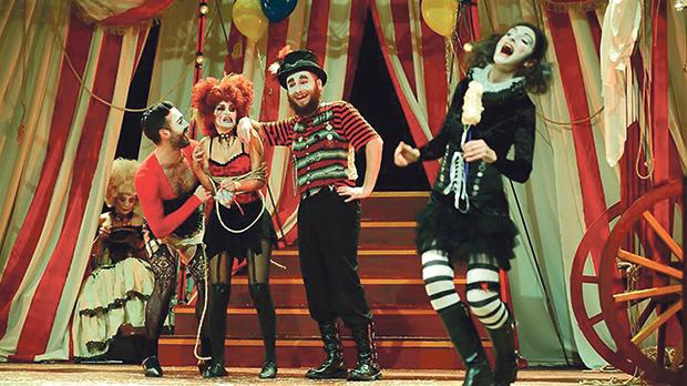 The cast is made up in white-face make-up with grotesque Grande Guignol features, hair and costume.