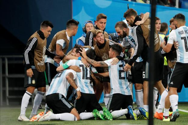 Argentina's Marcos Rojo celebrates scoring their second goal with teammates.