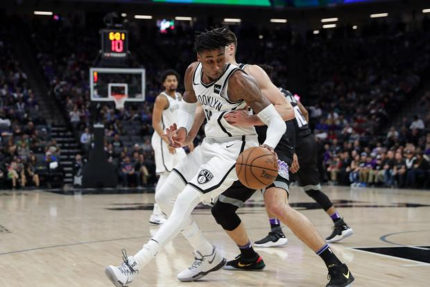 Brooklyn Nets forward Rondae Hollis-Jefferson (24) dribbles the ball against Sacramento Kings guard Bogdan Bogdanovic (8) during the second half at Golden 1 Center. Photo Credit: Sergio Estrada-USA TODAY Sports