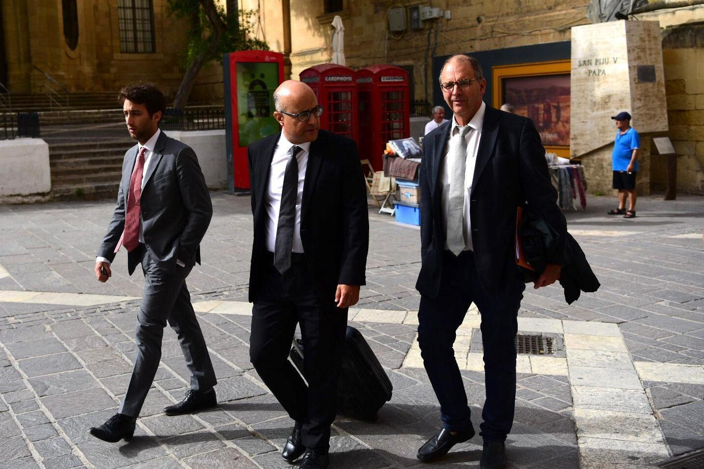 Matthew and Peter Caruana Galizia walk towards court earlier this month, with their lawyer Jason Azzopardi in between them. Photo: Mark Zammit Cordina