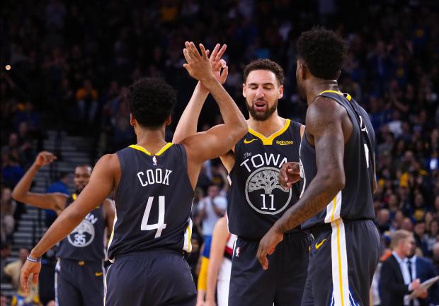 Golden State Warriors guard Quinn Cook (4) celebrates with Golden State Warriors guard Klay Thompson (11) after a play against the Portland Trail Blazers during the fourth quarter at Oracle Arena. Mandatory Credit: Kelley L Cox-USA TODAY Sports